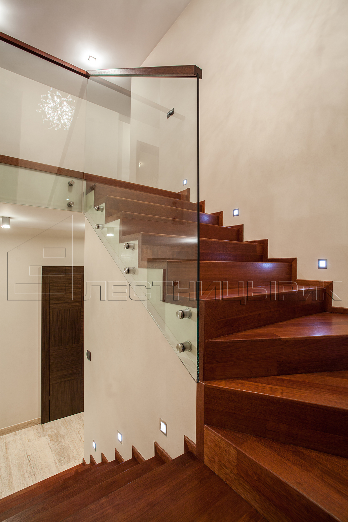 Travertine house - Wooden glass staircase in modern interior